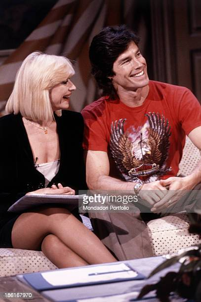 Italian TV presenter actress singer and showgirl Raffella Carrà talking with American actor Ronn Moss in the TV show Week end con Raffaella Beautiful...