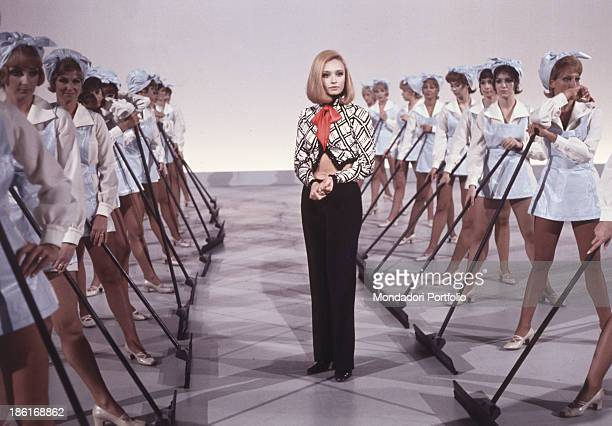 Italian TV presenter actress singer and showgirl Raffella Carrà dancing with the corps de ballet of the TV music show Canzonissima Italy 1971