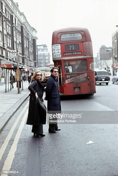 Italian TV presenter actress singer and showgirl Raffella Carrà walking with her partner Italian radio host director and TV author Gianni Boncompagni...