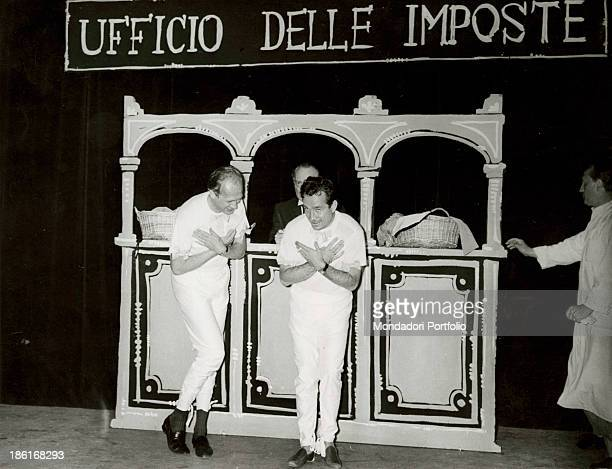 Italian TV presenter and actor Raimondo Vianello and Italian actor director and scriptwriter Ugo Tognazzi bringing hands to the chest in front of a...