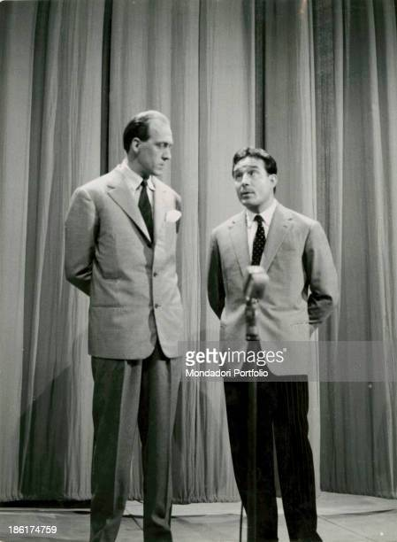 Italian TV presenter and actor Raimondo Vianello and Italian actor director and scriptwriter Ugo Tognazzi playing a gag in the TV variety show put on...