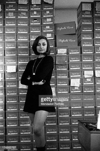 Italian TV presenter and showgirl Raffaella Carrà posing in front of some shoe in the factory that produces shoes bearing her name San Mauro Pascoli...