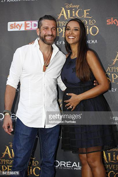 Italian TV presenter Edoardo Stoppa and his pregnant partner and Brazilian showgirl Juliana Moreira posing on the red carpet at the national premiere...