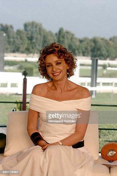 Italian Tv presenter Enrica Bonaccorti posing in a white dress for a photo shooting shooted in the TV studio of the show 'Il mio migliore amico'...