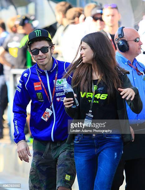 Italian Valentino Rossi escorts his girlfriend Linda Morselli through the MotoGP paddock at Comunitat Valenciana Ricardo Tormo Circuit on November 8...