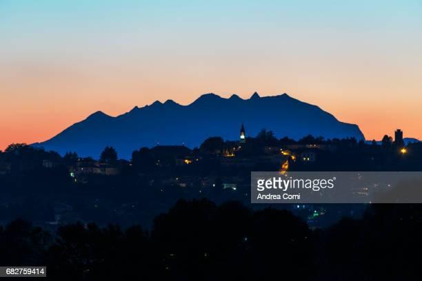 Italian village at Twilight. Monte Rosa in silhouette in the background. Montevecchia, Lecco, Lombardy