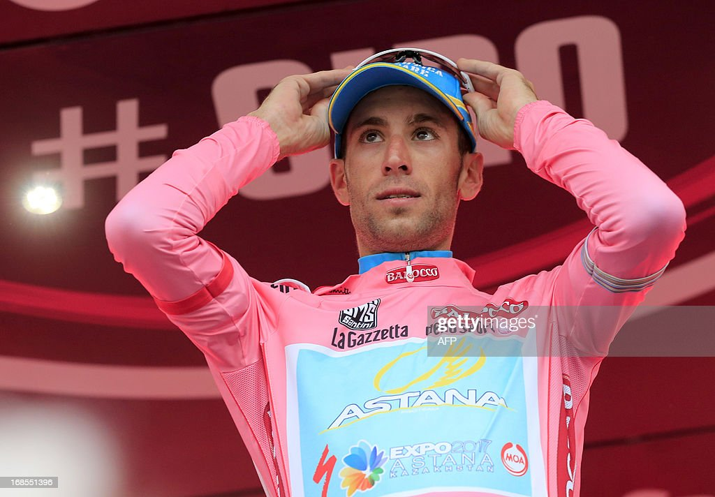 Italian Vincenzo Nibali celebrates on the podium the pink jersey after the 55,5kms eigth stage of the 96th Giro d'Italia time trial from Gabicce Mare to Saltara on May 11, 2013 in Saltara, Italy. iton Alex Dowsett took the honours ahead of compatriot Bradley Wiggins in the Tour of Italy's eighth stage time trial on Saturday with Italian Vincenzo Nibali inheriting the leader's pink jersey.