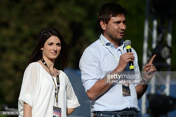 Italian Virginia Raggi Five Star Movement candidate for the election of Rome's mayor stands by M5S member Alessandro Di Battista during a campaign...