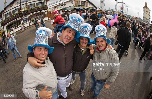 Italian visitors pose at the Oktoberfest 2013 beer festival at Theresienwiese on October 1 2013 in Munich Germany At the funfair attraction 'Hau den...