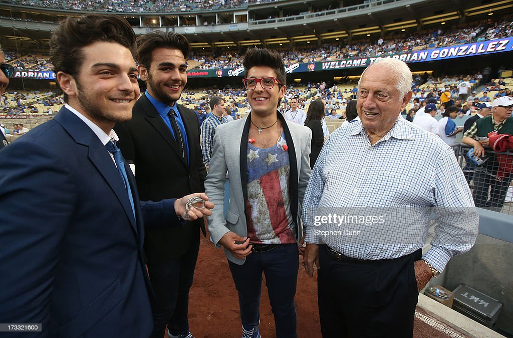 Italian vocal group Il Volo (L to R) Gianluca Ginoble, <a gi-track='captionPersonalityLinkClicked' href=/galleries/search?phrase=Ignazio+Boschetto&family=editorial&specificpeople=5945023 ng-click='$event.stopPropagation()'>Ignazio Boschetto</a>, and <a gi-track='captionPersonalityLinkClicked' href=/galleries/search?phrase=Piero+Barone&family=editorial&specificpeople=5945024 ng-click='$event.stopPropagation()'>Piero Barone</a> meet Dodger legend <a gi-track='captionPersonalityLinkClicked' href=/galleries/search?phrase=Tommy+Lasorda&family=editorial&specificpeople=206834 ng-click='$event.stopPropagation()'>Tommy Lasorda</a> before the game between the Colorado Rockies and the Los Angeles Dodgers at Dodger Stadium on July 11, 2013 in Los Angeles, California.