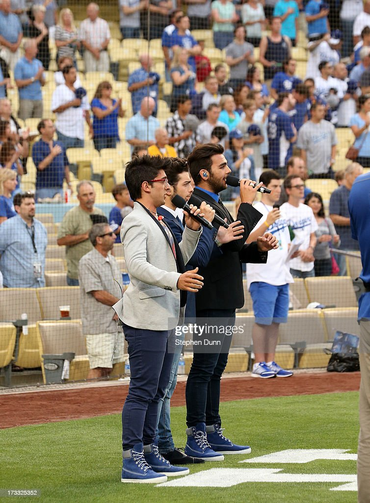 Italian vocal group Il Volo (L to R) <a gi-track='captionPersonalityLinkClicked' href=/galleries/search?phrase=Piero+Barone&family=editorial&specificpeople=5945024 ng-click='$event.stopPropagation()'>Piero Barone</a>, <a gi-track='captionPersonalityLinkClicked' href=/galleries/search?phrase=Gianluca+Ginoble&family=editorial&specificpeople=5945022 ng-click='$event.stopPropagation()'>Gianluca Ginoble</a> and <a gi-track='captionPersonalityLinkClicked' href=/galleries/search?phrase=Ignazio+Boschetto&family=editorial&specificpeople=5945023 ng-click='$event.stopPropagation()'>Ignazio Boschetto</a> sing the US national anthem before the game between the Colorado Rockies and the Los Angeles Dodgers at Dodger Stadium on July 11, 2013 in Los Angeles, California.