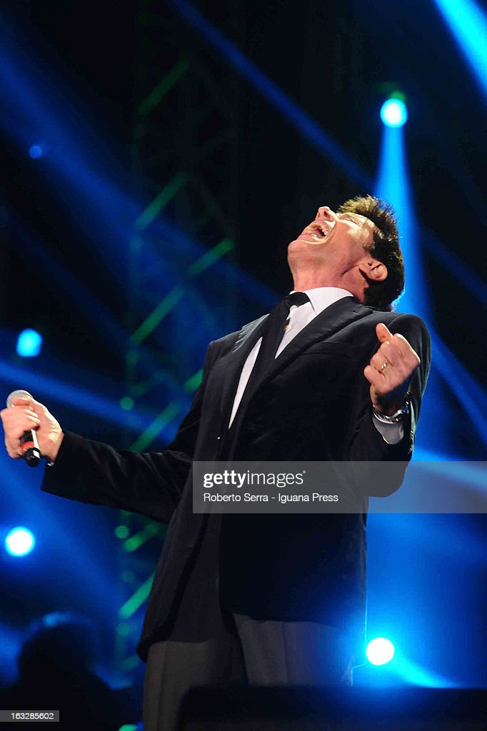 Italian vocalist <a gi-track='captionPersonalityLinkClicked' href=/galleries/search?phrase=Gianni+Morandi&family=editorial&specificpeople=2364530 ng-click='$event.stopPropagation()'>Gianni Morandi</a> performs the Lucio Dalla Tribute at Piazza Maggiore on March 4, 2013 in Bologna, Italy.