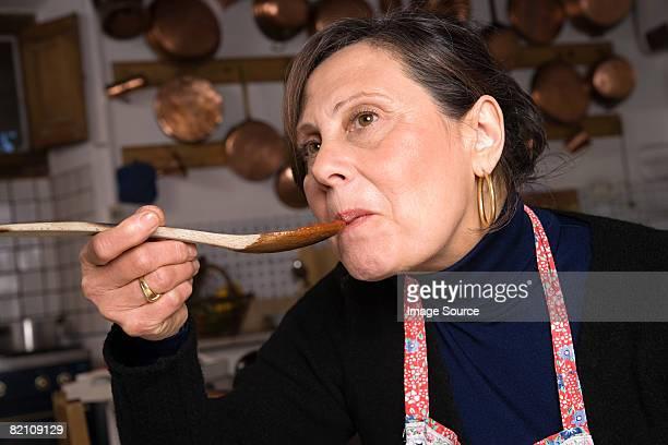 Italian woman sampling food