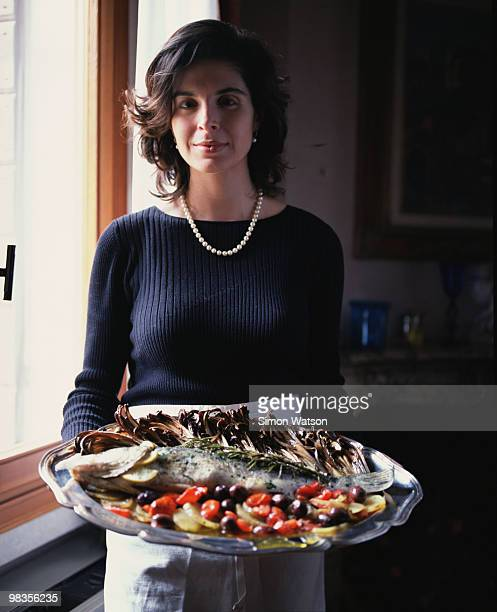 Italian woman with tray of fish and antipasto