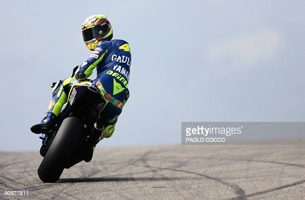 Italian world champion Valentino Rossi of the Moto GP team rides his Yamaha M1 at the Mugello racetrack 05 June 2004 during a free practice session...