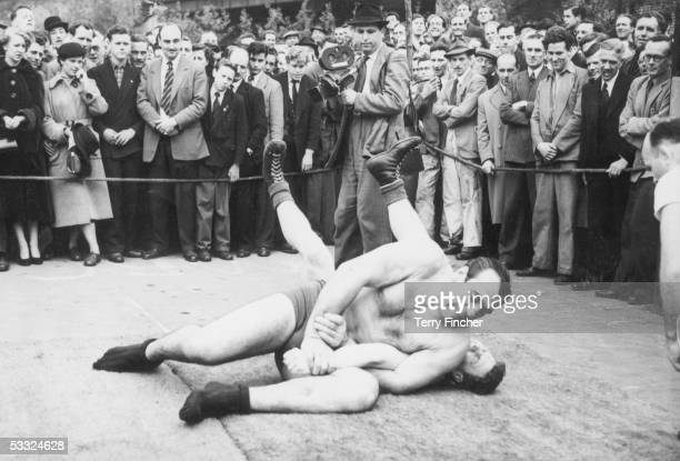Italian wrestler Primo Carnera training with British junior wrestling champion Al Hayes in preparation for his fight with Jack Doyle 8th May 1952...