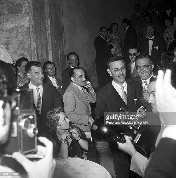 Italian writer and director Mario Soldati being congratulated for his Strega Prize at Villa Giulia Rome 1954