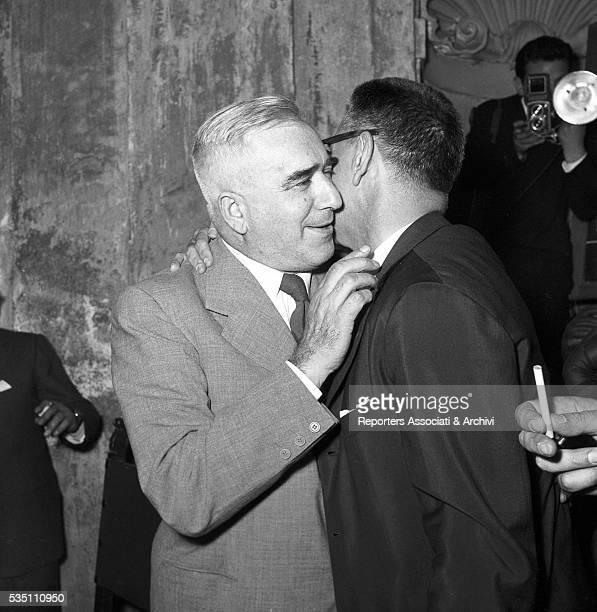 Italian writer and director Mario Soldati congratulating Italian writer and winner of the Strega Prize Giovanni Comisso at Villa Giulia Rome 1955