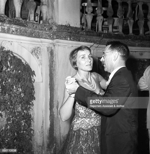 Italian writer and director Mario Soldati winner of the Strega Prize and his wife Giuliana Kellermann dancing during the awarding ceremony held at...