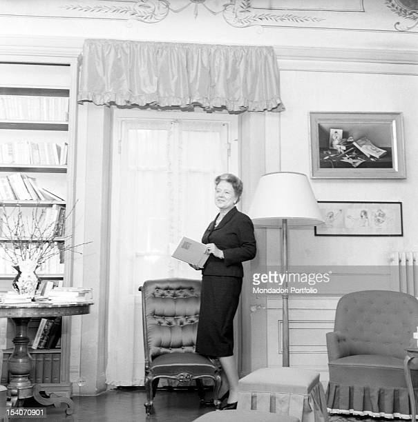 Italian writer and translator Anna Banti photographed with a book in hand in her fashionable house in Florence embellished by many artworks Florence...