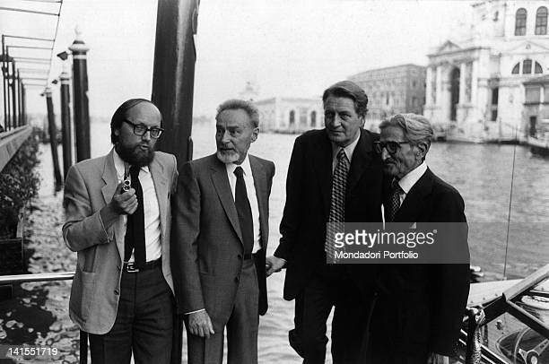 Italian writer partisan and chemist Primo Levi posing with writers Antonio Terzi and Ferruccio Parazzoli in Venice Venice 1982