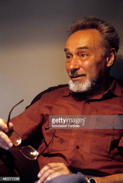 Italian writer Primo Levi sitting with his eyeglasses in the hand Turin 1981