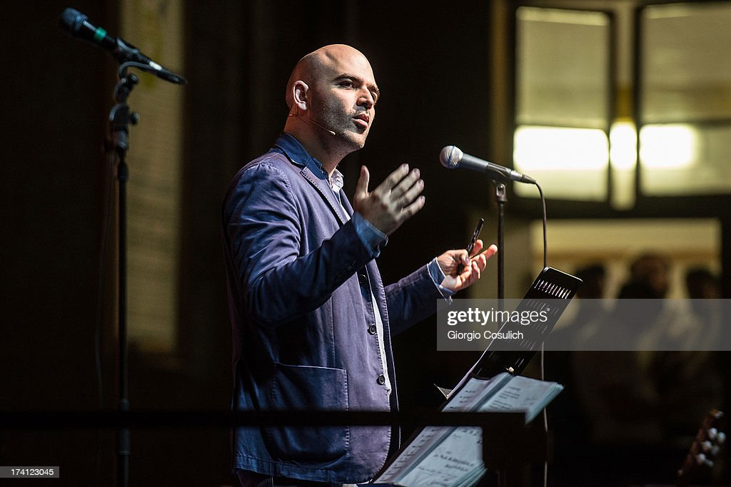 Italian writer <a gi-track='captionPersonalityLinkClicked' href=/galleries/search?phrase=Roberto+Saviano&family=editorial&specificpeople=3964077 ng-click='$event.stopPropagation()'>Roberto Saviano</a> gives a reading at Palace of Culture in the Ghetto district during the opening of the International Festival of Jewish Culture and Literature on July 20, 2013 in Rome, Italy. The International Festival of Jewish Culture will take place July 20 to 25.