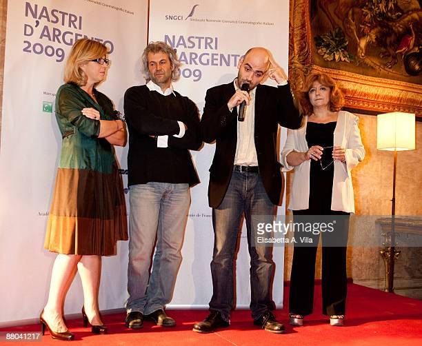 Italian writer Roberto Saviano producer Domenico Procacci and Laura Delli Colli attend 2009 Nastri D'Argento Nominations Dinner Party at Villa Medici...