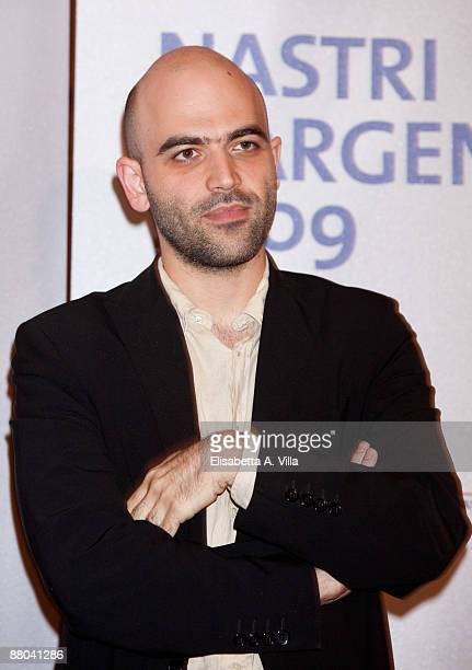 Italian writer Roberto Saviano receives the award for the movie 'Gomorra' during the 2009 Nastri D'Argento Nominations Dinner Party at Villa Medici...