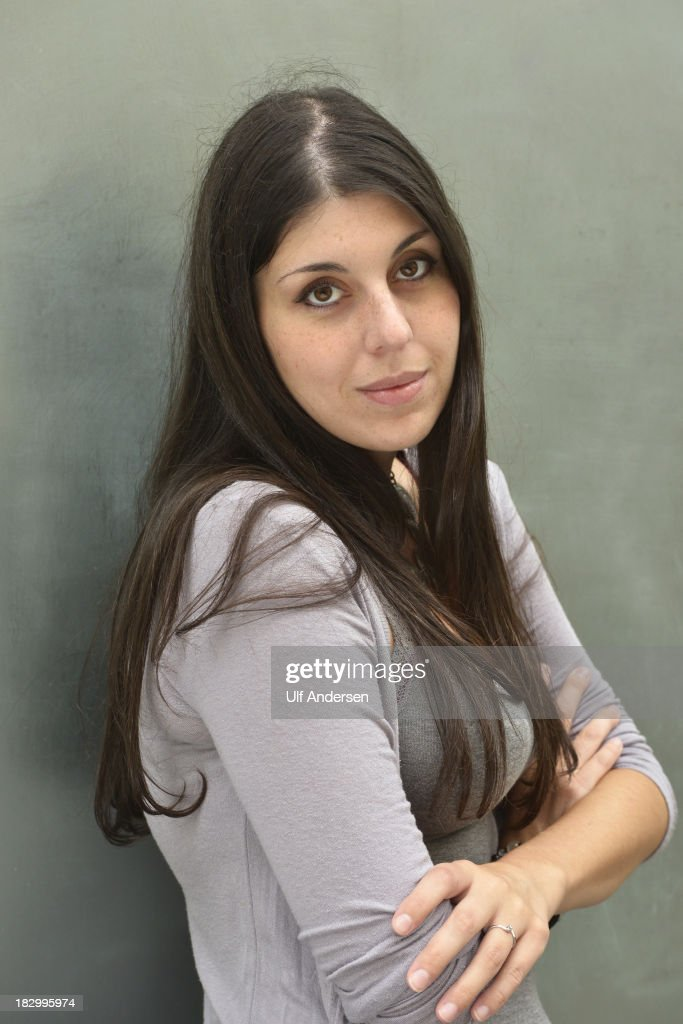 PARIS, FRANCE - SEPTEMBER 26. Italian writer Valentina D'Urbano poses during a portrait session on September 26, 2013 in Paris, France.