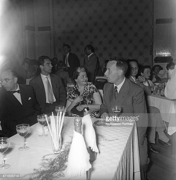 Italian writers Giorgio Bassani and Italo Calvino sitting at the table at the Incontri Letterari former San Pellegrino Awards San Pellegrino Terme...