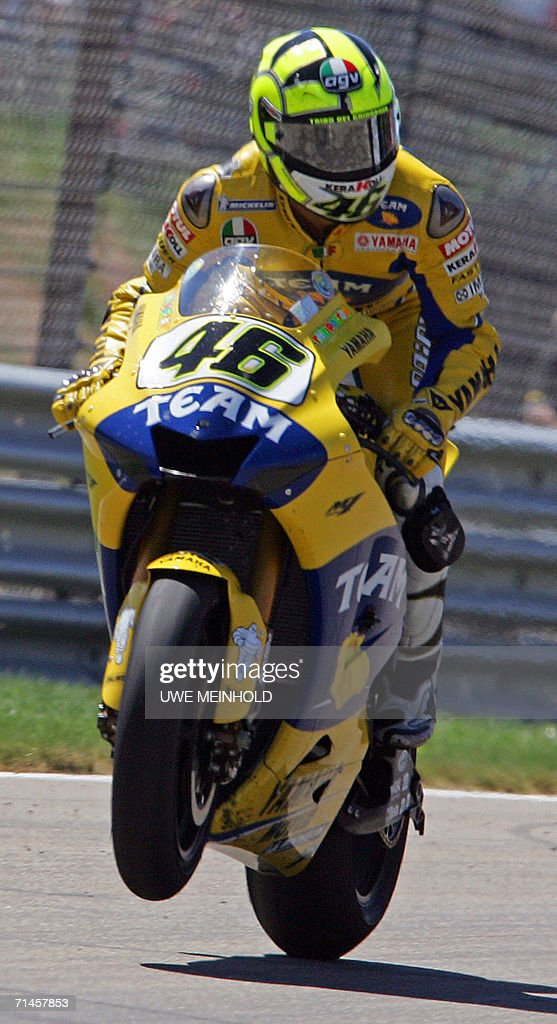Italian Yamaha rider Valentino Rossi wins the 2006 Grand Prix Moto GP at the Sachsenring racetrack in HohensteinErnstthal eastern Germany 16 July...