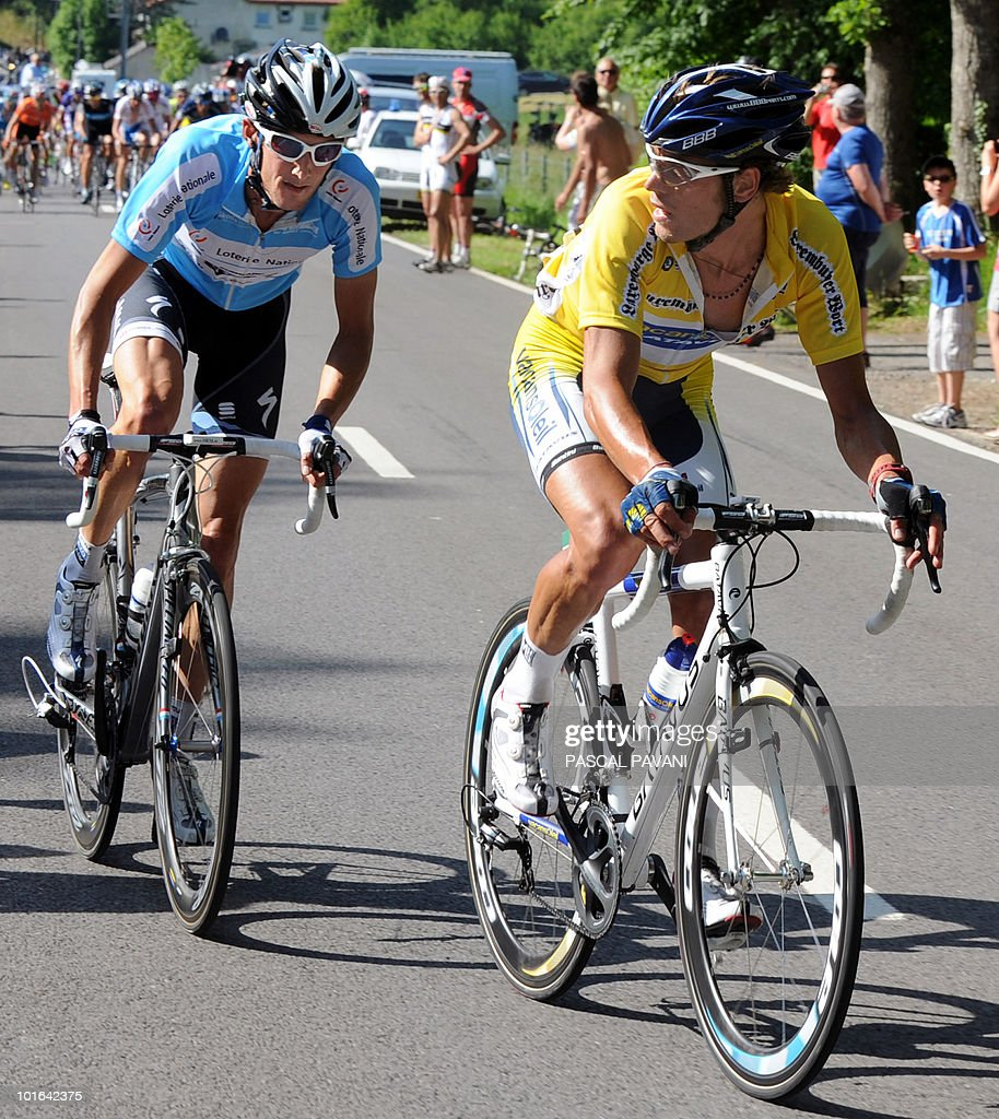 Italian yellow jersey leader Matteo Carrara (R) and Luxembourg's Franck Schleck (L) ride during the 'Tour du Luxembourg' cycling race third stage between on June 05, 2010 between Eschweiler and Diekirch. France's Tony Gallopin won the stage.