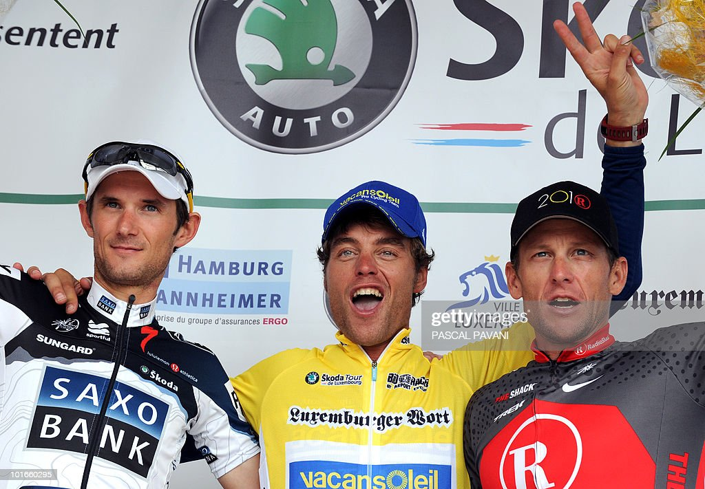 Italian yellow jersey Matteo Carrara (C) celebrates next to Luxembourg's Franck Schleck (L) and US Lance Armstrong (R) on the podium of the 'Tour of Luxembourg' on June 5, 2010 in Luxembourg. Matteo Carrara won the race ahead of Franck Schleck and Lance Armstrong.
