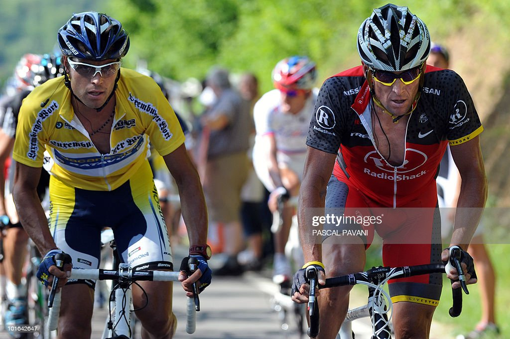 Italian yellow jersey Matteo Carrara (L) rides with US Lance Armstrong (R) during the 'Tour du Luxembourg' cycling race third stage on June 5, 2010 between Eschweiler and Diekirch. France's Tony Gallopin won the stage.