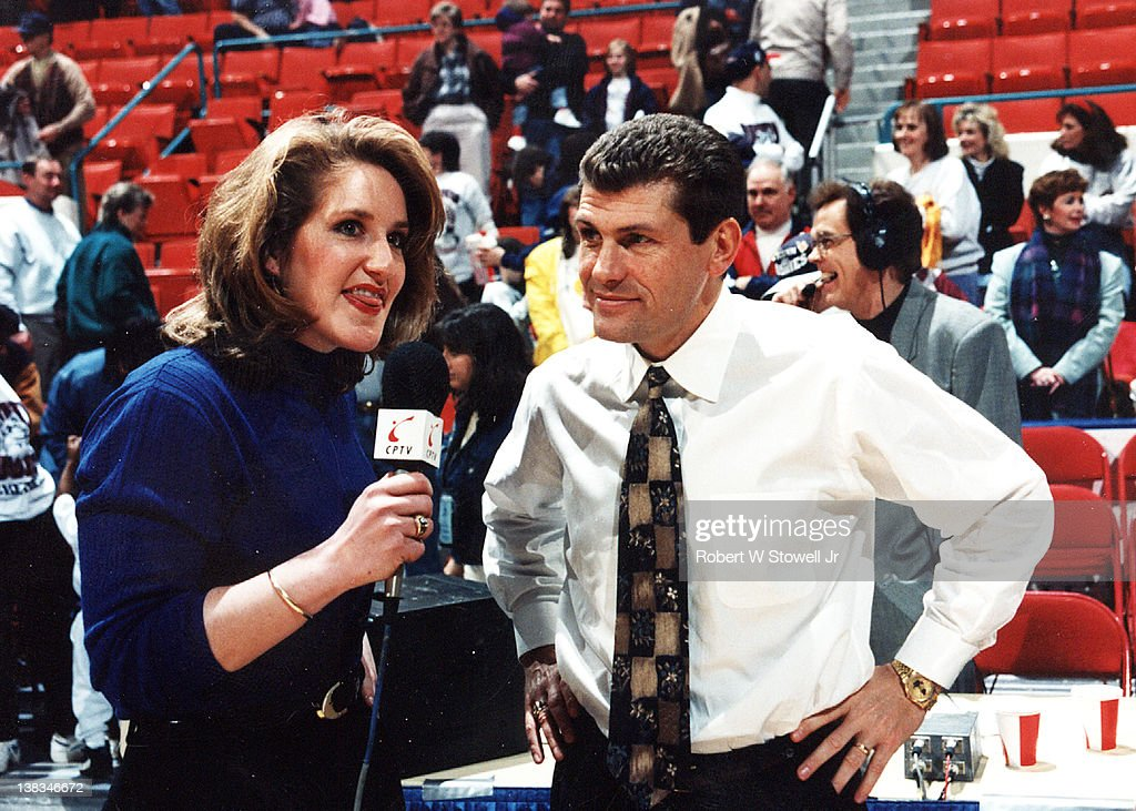Italian-born American basketball coach <a gi-track='captionPersonalityLinkClicked' href=/galleries/search?phrase=Geno+Auriemma&family=editorial&specificpeople=704607 ng-click='$event.stopPropagation()'>Geno Auriemma</a> (right) of the University of Connecticut is interviewed by player Meghan Pattyson after a game, Storrs, Connecticut, 1995.