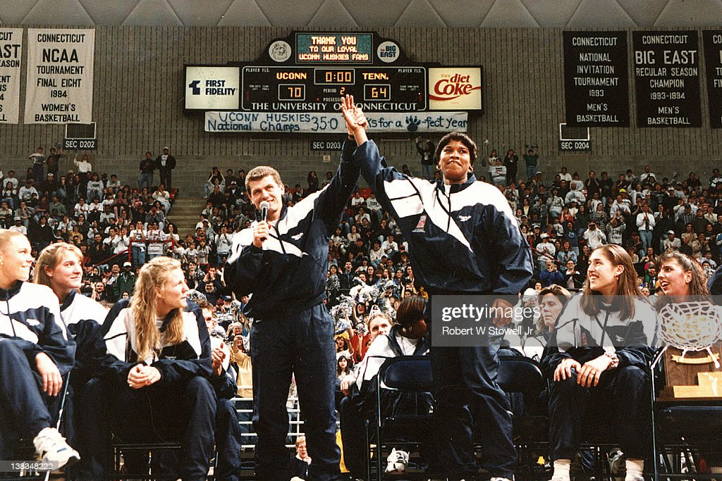 Italian-born American basketball coach <a gi-track='captionPersonalityLinkClicked' href=/galleries/search?phrase=Geno+Auriemma&family=editorial&specificpeople=704607 ng-click='$event.stopPropagation()'>Geno Auriemma</a> of the University of Connecticut introduces player Jamelle Elliott at a pep rally in their honor following their victory at the 1995 National Championship, Storrs, Connecticut, 1992.