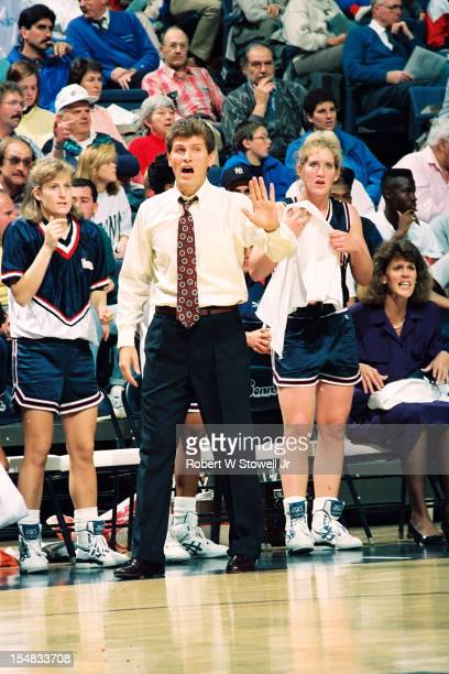 Italianborn American women's basketball coach Geno Auriemma of the University of Connecticut raises his hand to protest a call during a game Storrs...