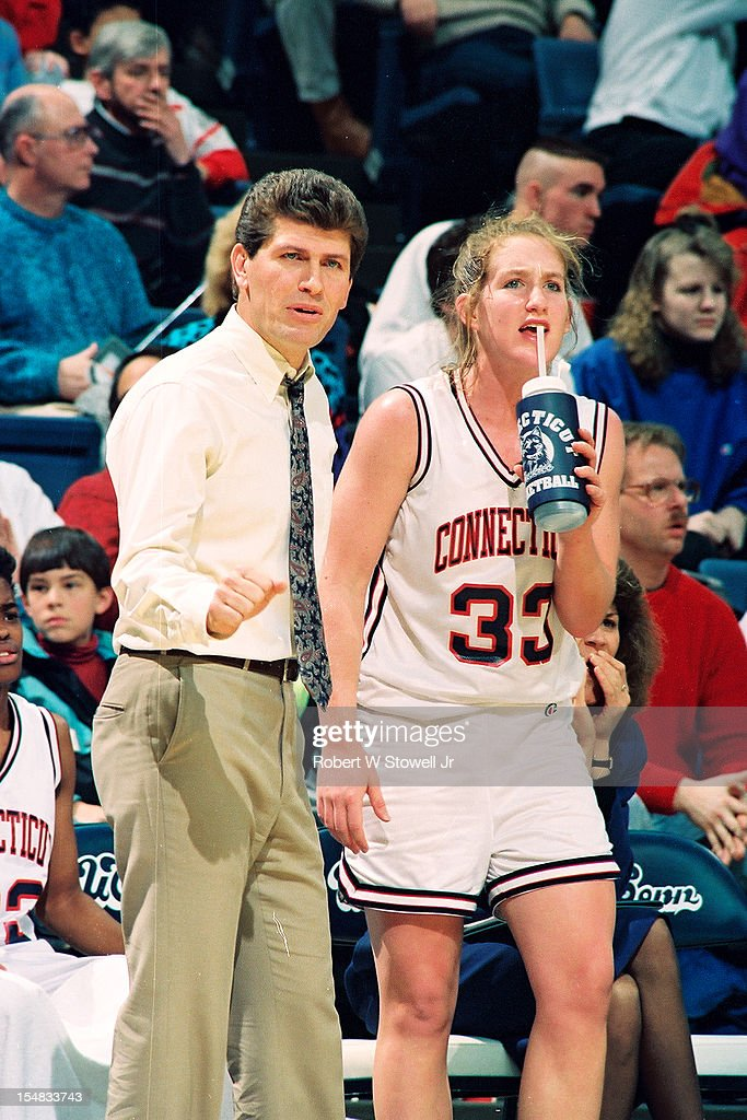 Italian-born American women's basketball coach <a gi-track='captionPersonalityLinkClicked' href=/galleries/search?phrase=Geno+Auriemma&family=editorial&specificpeople=704607 ng-click='$event.stopPropagation()'>Geno Auriemma</a>, of the University of Connecticut, stands courtside with one of his players, Meghan Pattyson, during a game, Storrs, Connecticut, 1990.