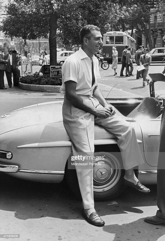 Italianborn Brazilian entrepreneur Baby Pignatari smiling beside a Mercedes cabrio car Rome June 1968