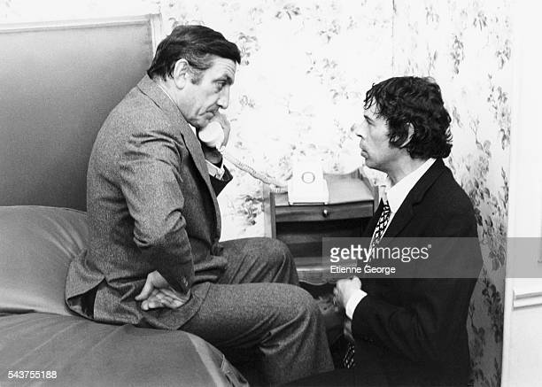 Italianborn French actor Lino Ventura and Belgian singer and actor Jacques Brel on the set of 'L'Emmerdeur' directed by Edouard Molinaro and based on...