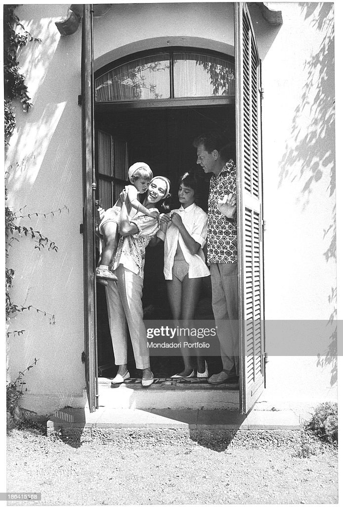 Italian-born French actress Marisa Pavan (Marisa Pierangeli), with her son Jean-Claude Aumont in her arms, smiling with French actor Jean-Pierre Aumont and <a gi-track='captionPersonalityLinkClicked' href=/galleries/search?phrase=Tina+Aumont&family=editorial&specificpeople=2008606 ng-click='$event.stopPropagation()'>Tina Aumont</a>, daughter of the actor. Sankt Moritz, 1959.