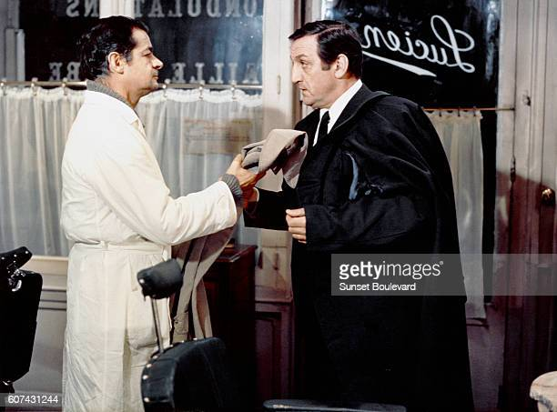 Italianborn French singer and actor Serge Reggiani and Italian actor Lino Ventura on the set of L'Armée des Ombres based on the novel by Joseph...