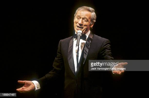 Italianborn French singer and actor Yves Montand performs during the Metropolitan Opera's gala 'Celebration' commemorating its 100 year anniversay at...