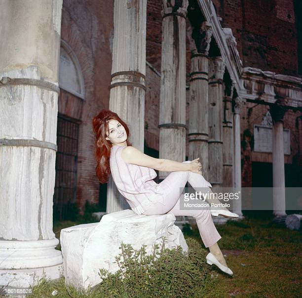 Italianborn French singer Dalida posing in front of a colonnade at the Imperial Fora Rome 1950s