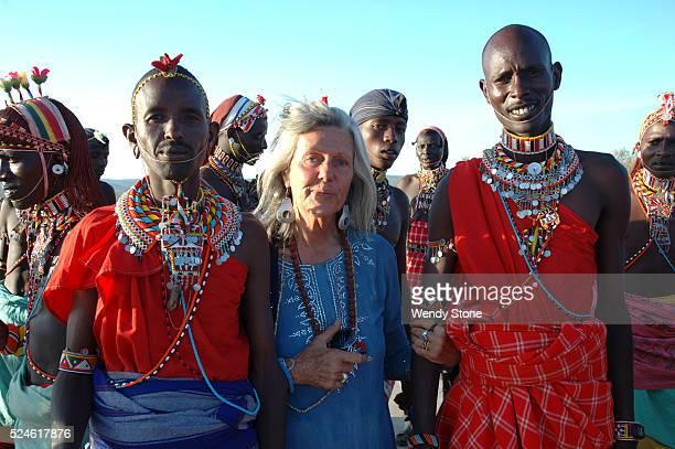 Italianborn Kenyan author poet environmental activist and conservationist Kuki Gallmann links arms with her Rendille and Samburu friends during the...