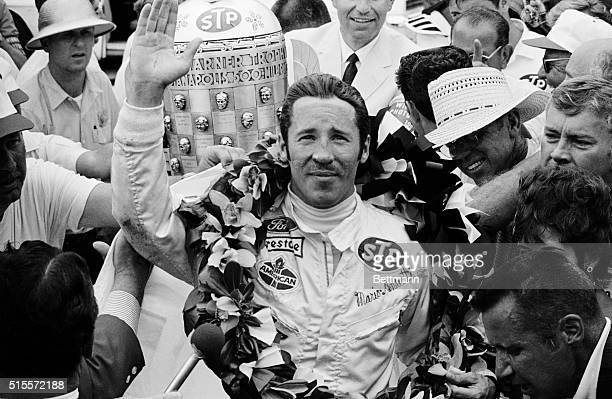 Italianborn Mario Andretti of Nazareth Pennsylvania is bedecked with flowers after winning the Indianapolis 500mile race at Indianapolis speedway May...
