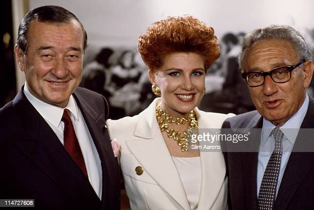 Italianborn restaurateur Sirio Maccioni with former US Secretary of State Henry Kissinger and an unknown woman at Maccioni 's restaurant Le Cirque...