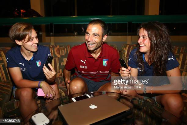 Italians head coach Enrico Sbardella is interviewed by his players Lisa Boattin and Flaminia Simonetti at Barcelo Hotel on March 24 2014 in Alajuela...