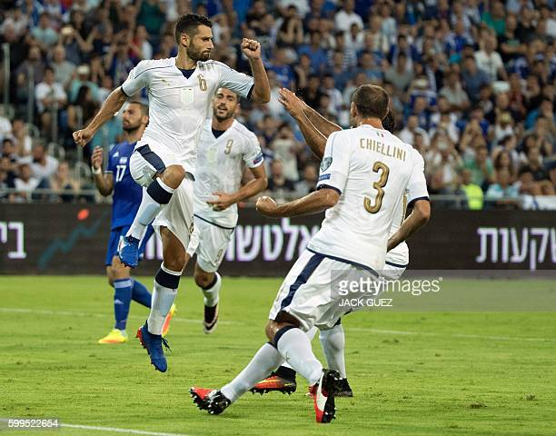 Italian's midfielder Antonio Candreva celebrates with his teammates after scoring a goal during their World Cup 2018 qualification match between...